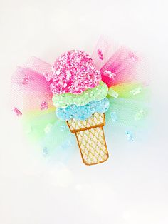 3 WEEK TURNAROUND... NEED IT SOONER? MESSAGE ME. ICE CREAM CONE Tulle bow Available as a HAIR CLIP, MINI BARRETTE OR HEADBAND. Measures: Tulle bow - 3 1/4 inches Ice Cream Cone - 3 inches Hair Clip - attached to a double pronged alligator clip covered in ribbon of coordinating color