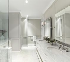 Glam gray bathroom with marble countertops