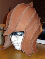 Leather elven helm how-to.  It's written in Czech... but there are some patterns, and with a translator I can probably figure it out!
