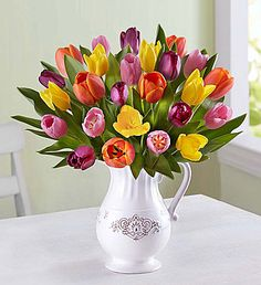 Welcome Spring™ Tulip Bouquet EXCLUSIVE What better way to welcome spring than with our bright tulips? We've gathered bold blooms in a variety of shades in our exclusive Charlotte Pitcher, an antique-inspired, white, food-safe ceramic pitcher that can be repurposed as a serving vessel or décor piece!