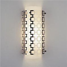 Jonathan Adler Grid Wall Sconce Polished NIckel. 60 watt candle base bulb (not included). Measurement from top to middle of backplate is 7.5. (15Hx7Wx3.5D)  Product SKU: SC09011 PN Price:  $179.00