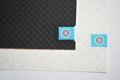 Embossed business cards with sticker tabs.