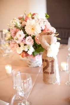 lace wrapped container - mixture of florals  - wine bottle table number in burlap @Megan Chilton