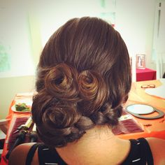 bridesmaid hair -french braid into side do with vintage rolls.