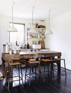 Love this rustic  industrial kitchen!