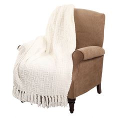 This stunning cable knit throw is available in red, white and burgundy to accent your decor. The tassled fringe completes the look.