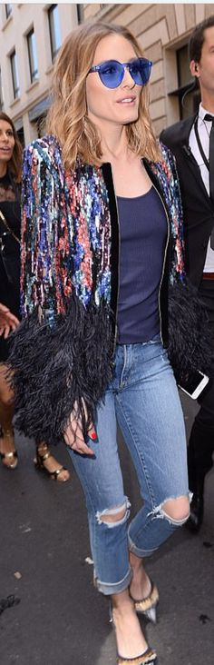 Who made Olivia Palermo's blue sunglasses and feather sequin jacket?