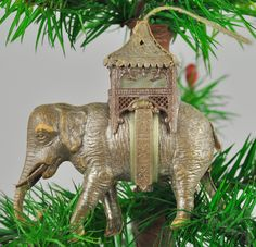 Antique Dresden Christmas ornament, silver elephant with howdah. Roof is removable to conceal candy or small jewelry.