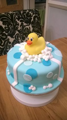 An adorable rubber ducky baby shower cake with ducky as topping. Ducky Baby Showers, Baby Shower Duck, Rubber Ducky Baby Shower, Baby Shower Cakes For Boys, Baby Boy Cakes, Bee Cakes, Fondant Cakes, Baby Boy Birthday, First Birthday Cakes