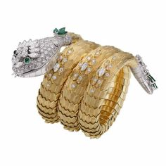 A watch Serpenti in yellow gold and platinum with diamonds and emeralds from…