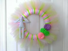 Easter Wreath, Bunny Wreath, Spring Wreath-  Easter Pastel Tulle Wreath with Muslin Bunny and Felt Flowers by YourFourSeasonsDecor on Etsy https://www.etsy.com/listing/184657086/easter-wreath-bunny-wreath-spring-wreath