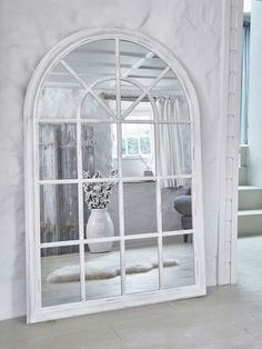 This extra large arched wooden loft style window mirror has a beautifully soft distressed paint finish.