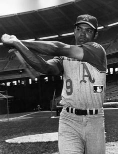 American athlete Reggie Jackson of the Oakland Athletics, swinging a bat while in uniform, on the field of an empty baseball stadium. (Photo by Hulton Archive/Getty Images) Baseball Star, Sports Baseball, Baseball Players, Baseball Cards, Reggie Jackson, Brandon Jackson, Michael Jackson, American Athletes, Baseball Pictures