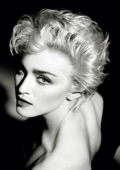 This would be a flattering pose for almost every woman. Madonna photographed by Herb Ritts.
