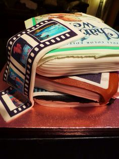 Three tiers book stack cake with photo reel. Carrot cake, coffee cake and chocolate cake