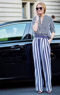 Olivia Palermo wears Dior sunglasses with a striped blouse and striped trousers