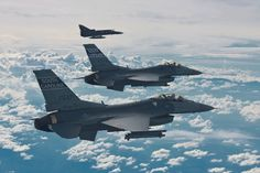 https://flic.kr/p/s6BS8N | Flying Over the Clouds | Edited USAF image of F-16s from the South Carolina Air National Guard flying over Rionegro, Colombia.  Original caption: U.S. Air Force F-16 Fighting Falcon aircraft attached to the 169th Fighter Wing, South Carolina Air National Guard fly alongside Colombian Air Force Kfir aircraft attached to the 111th Combat Squadron during Relampago 2014 over Rionegro, Colombia, Aug. 12, 2014. Relampago is an aerial exercise designed to strengthen ties…