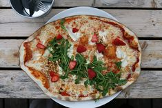 Summer Pizza with Goat Cheese, Pine Nuts, Rucola and Strawberries