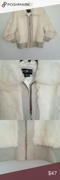 WHITE FUR Coat White Fur Coat fully lined. With 2 functional pockets. 85% rabbit. 15% genuine leather. Gently Used item and Dry Clean Only. MIX IT Jackets & Coats Puffers