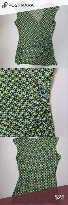 Max Studio Faux Wrap Sleeveless Top. Sz S. Max Studio Faux Wrap Sleeveless V-neck  Top. Sz S with modern apple green, light blue, brown and white flowers and squares print. It has a very flatering ruching on the side. Excellent condition, only a small detail on the back hem (shown in picture). Max Studio Tops