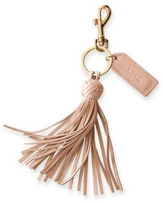An easy yet thoughtful gift, this lovely leather keychain combines a fringed tassel, gold hardware and a functional key ring with a leather tag that was made for monogramming. Tote Bags, Duffle Bags, Clutch Bags, Messenger Bags, Leather Money Clip Wallet, Diy Keychain, Diy Leather Keychain, Leather Fringe, Leather Totes