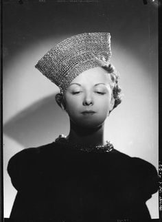 ca.1935. Braid hat. Unknown milliner. Photo by François Kollar. French Photographic Archive.
