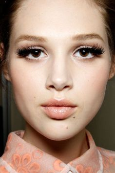 this is a little more stylized than you might want, but i love the big lashes and neutral peachy everything else.