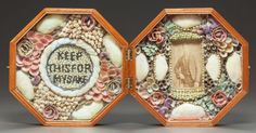 Decorative Arts, Continental, A DOUBLE SHELL-WORK SAILOR'S VALENTINE IN HINGED OCTAGONAL BOX.Barbados, 19th century. Marks to box exterior: ...