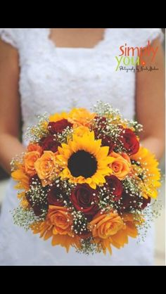 I'm starting to lean towards a bouquet with sunflowers