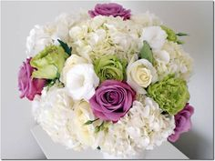 R-27. Bouquet with hollandaise Hydrangea, lisianthus and Roses. Available for purchase and upgrade.