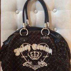 """Juicy Couture Quilted Purse This is 100% authentic. It was a present from my father and it was bought from Nordstrom. In very good condition. Has been stored in the dust bag. I've had this purse for 8 years. Sad to part with it. It's a large bag with a zippered pocket that says """"Shop"""" and another pocket that's quilted velour like the outside of the bag. Juicy Couture Bags"""