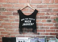 A personal favorite from my Etsy shop https://www.etsy.com/listing/465185495/who-tf-is-mick-jagger-tank