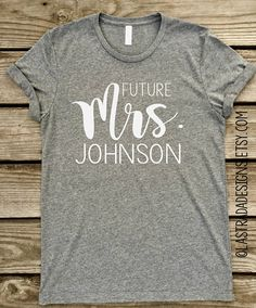 ❤️ ADD NEW LAST NAME IN THE NOTES TO SELLER UPON CHECKOUT ❤️ This Tee is my favorite... Its made up of 90% cotton and 10% polyester and will not shrink. Its also made with ring spun cotton, so that means its incredibly soft! Youll want to wear it everyday! ❤️This is a unisex Tshirt