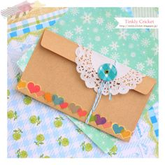 Envelope inspiration with doily, washi tape and string closure from Tinkly cricket: 茶封筒・宛名のデコレーション.