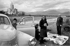 Henri Cartier-Bresson: The Modern Century A 1972 photo of a Georgian family picnicking near a medieval monastery