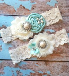 This gorgeous set of blue flowered garters by FallenStarCoutureInc via etsy is a great way to add a bit of blue, and a bit of bling, at the same time. #weddinggarters
