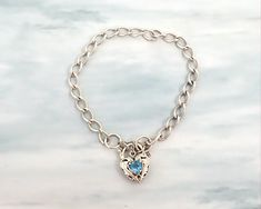 Sterling silver curb link bracelet with filigree heart padlock closure with blue topaz and safety chain, 10 grams by CardCurios on Etsy Old Fashioned Key, Blue Topaz Stone, Butterfly Earrings, Carat Gold, Gemstone Colors, Silver Charms, Link Bracelets, Filigree, Heart Shapes