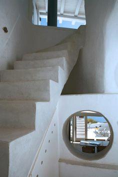 Peek-a-boo porthole! Great design in Santorini, Greece.