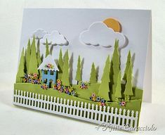 Love the tiny house, trees and tons of detail. Note the sun behind the cloud, and the flowers from 1/8 inch circle punch.