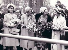 From left;Queen Farah Pahlavi, Charlotte Luxemburg), Juliana Netherlands and Elizabeth UK at a garden party by Playing By Heart, via Flickr