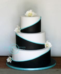 - Could put Teal where the Black is and Black where the Teal is........Teal, Black and Ivory wedding cake with gumpaste orchids.