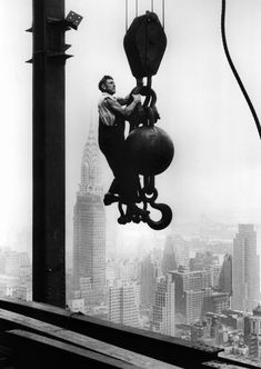 "Oct. 29, 1930 ""A construction worker hangs from an industrial crane during the construction of the Empire State Building."""