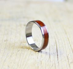 This unisex ring composed mahogany wood and stainless steel.  All the steps are handmade by me. A wonderful treat for yourself or a friend!  You can wearing everyday to office or any other occasion.  Size: in all size available!