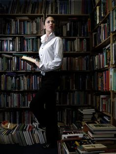 the contrast may be too obvious but should be acknowledged. Her head tilt and sideways posture leans to similarity with the books objects.