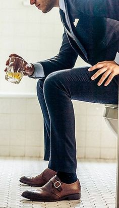 men dressed in dark navy suit with leather loafers... i'll have one of those, please.