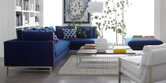 Clean-looking living room.  I love how the blue couches contrast with the white.