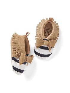 Adorable tan and navy striped moccasins with bow for baby girl
