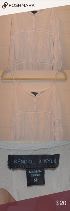 Medium White Flowy Kendall and Kylie Blouse Like new! No rips, holes, or stains. Super cute white open holed shoulders with spaghetti straps. Very flowy. Long sleeved. Size MEDIUM. Selling for $20. Kendall & Kylie Tops Blouses