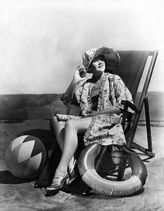 Surely I can't be the only who thinks fashionable beach coats - like this one from the 1920s - need to make a major comeback?