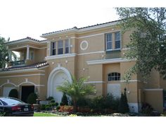 Stucco Two-Story With Elegant Formal Front Facade House Plans And More, Luxury House Plans, Florida Style, Florida Home, Florida House Plans, Southwestern Home, Mediterranean House Plans, Stucco Homes, Cost To Build